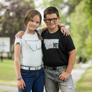10 year old girl featured in Jelt Youth Glacier White Jelt belt and 10 year old boy featured in Jelt Youth Digital Camo Jelt Belt.