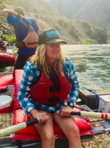 Jen Perry, president and CEO of Jelt on a raft on the Grand Canyon