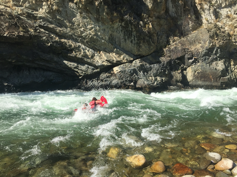 A friend of Jelt pictured riding a rapid on a river with a Paco Sleeping Pad