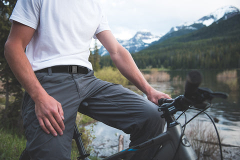 Man wearing a JeltX Adjustable belt on pants while mountain biking