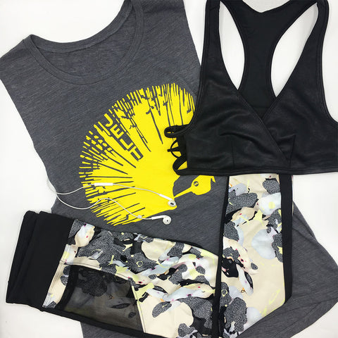 Jelt Mohawk Muscle Tank featured with Free People Sports Bra and Koral Activewear Magnify Leggings