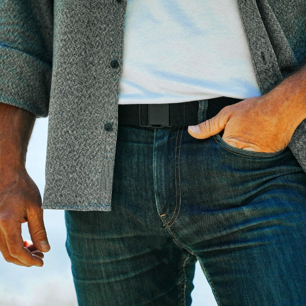 Jelt Venture Adjustable belt shown worn by a man with jeans, a white t-shirt and button down shirt.