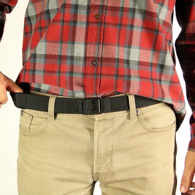 JeltX Adjustable black belt shown on a man with a plaid shirt and khaki pants.