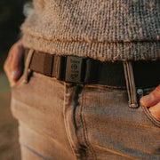 JeltX Adjustable on a woman wearing a grey sweater and grey jeans.