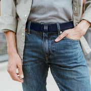 "Montana State University ""M"" JeltX Adjustable belt in navy by Jelt belts. Shown on a man in jeans and button-down shirt."