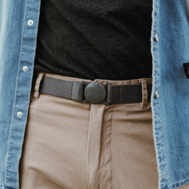 Man in khakis with a denim shirt wearing the new limited edition, steel grey Jelt elastic belt.