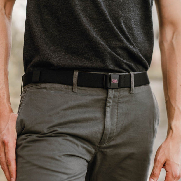 Man shown wearing a University of Montana Griz JeltX Adjustable  belt in black
