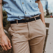 Man wearing denim navy blue Jelt elastic belt with khaki pants and a dress shirt