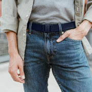 JeltX Adjustable belt in navy. Pictured on guy with jeans and button down shirt.