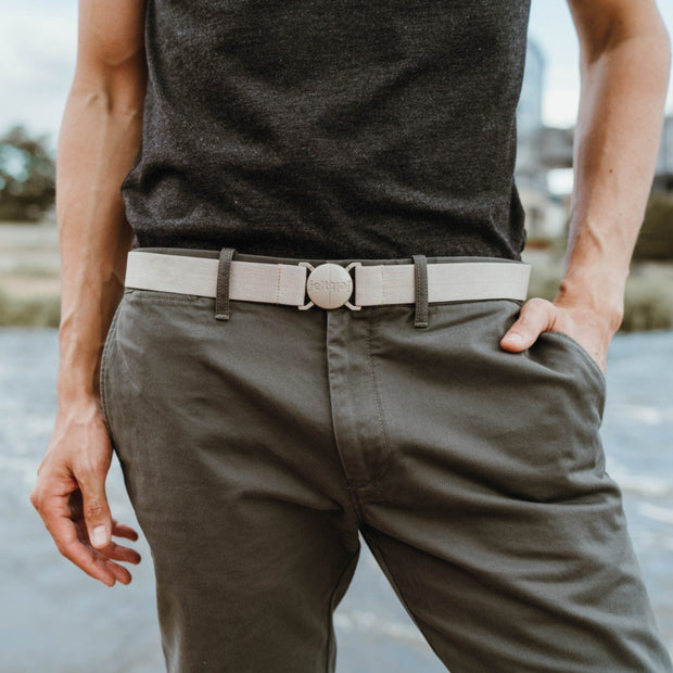 Khaki tank belt featured on a man wearing khaki pants