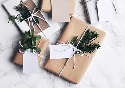 Wrap gifts with craft paper and greenery!