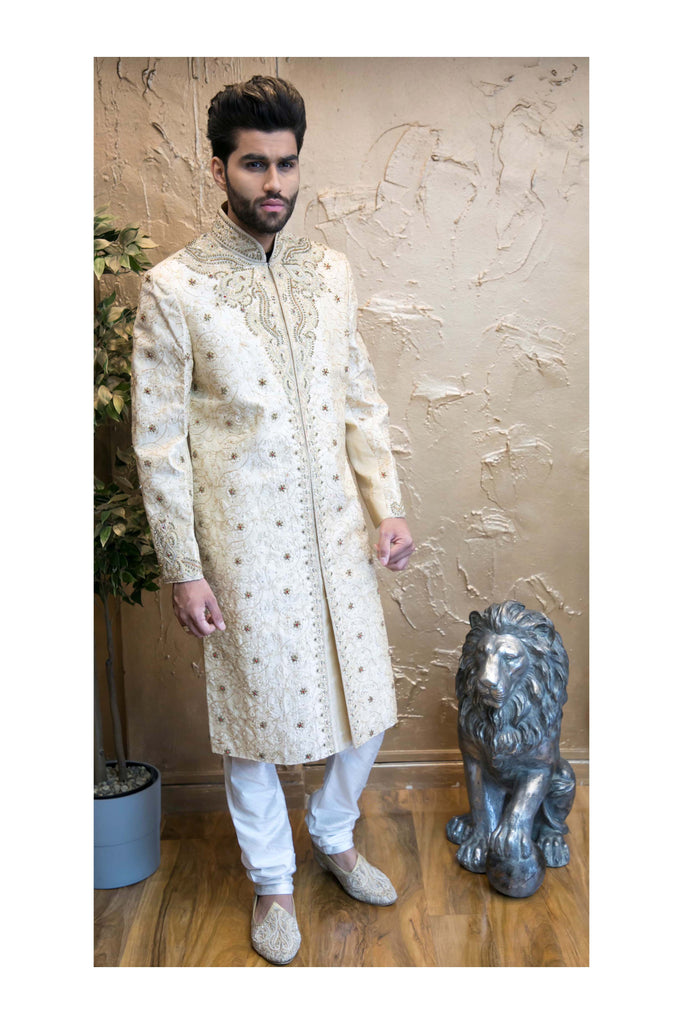 Gold Sherwani with Heavy Chest Piece Red Detailing