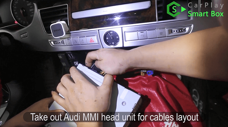 1.Take out Audi MMI head unit for cables layout.