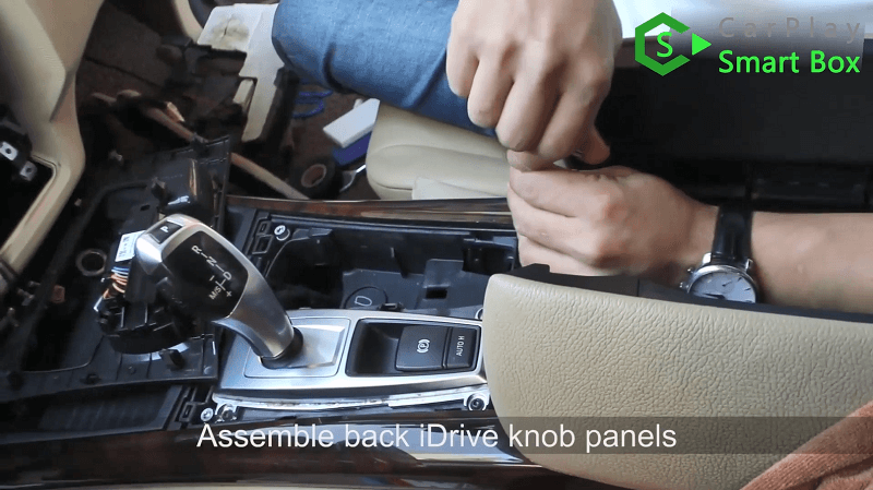 12.Assemble back iDrive knob panels.