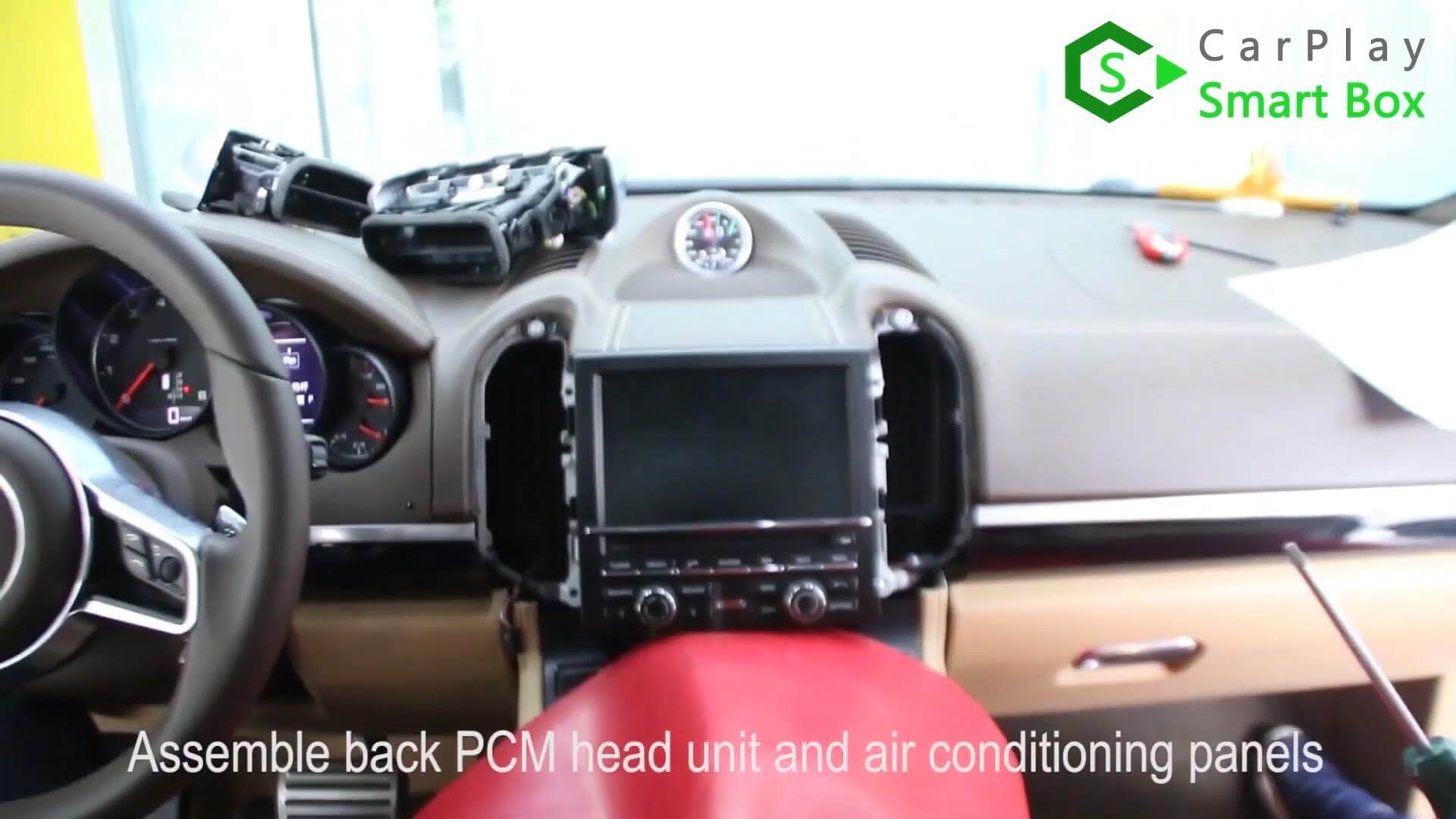 16. Assemble back PCM head unit and air conditioning panels -  Step by Step Retrofit Porsche Cayenne PCM3.1 WIFI Wireless Apple CarPlay - CarPlay Smart Box