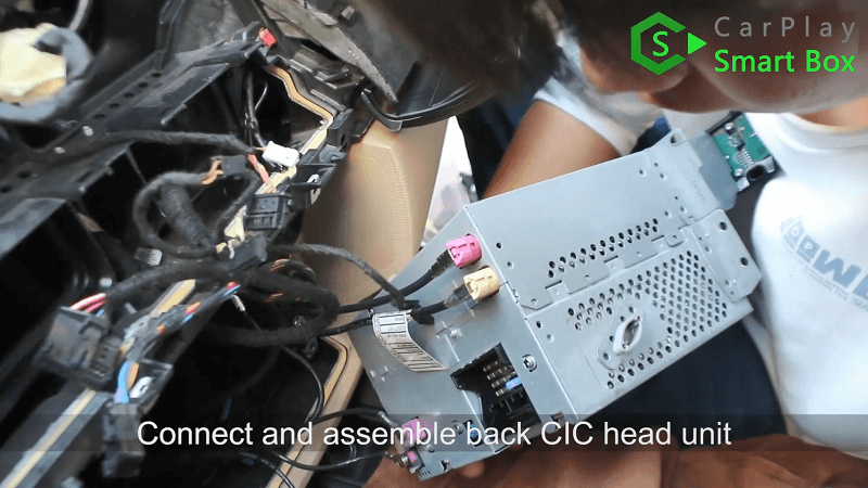 19.Connect and assemble back CIC head unit.