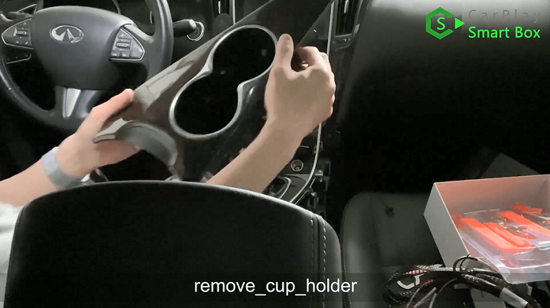 3.Remove cup holder.