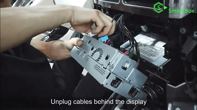 3.Unplug cables behind the display.