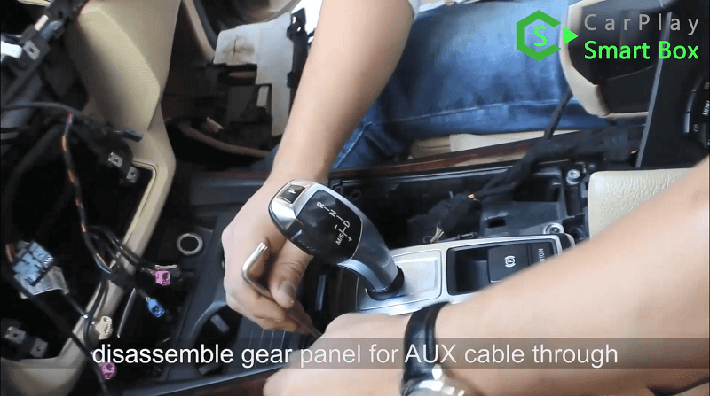 8.Disassemble gear panel for AUX cable through.