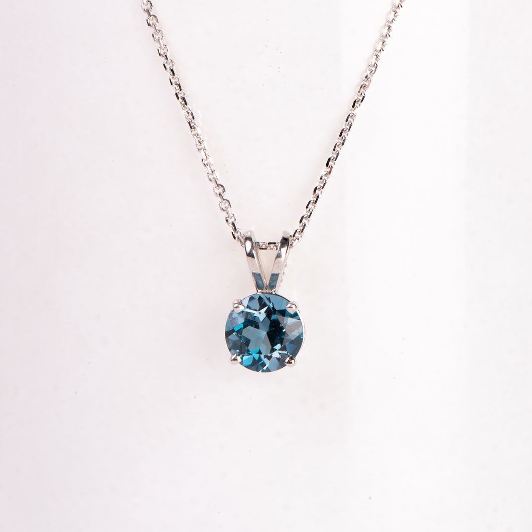14kt White Gold Blue Topaz Pendant