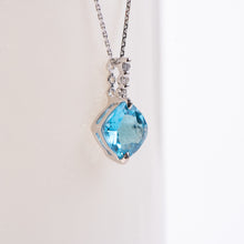 Load image into Gallery viewer, 14kt White Gold Blue Topaz  and Diamond Pendant