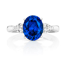 Load image into Gallery viewer, Three Stone Ring 10x8mm Blue Oval Centre And 4mm Hearts Claw Set