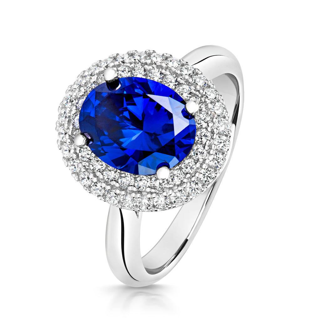 Double Halo Dress Ring With 10x8mm Blue Centre Oval