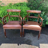 Pair of Regency mahogany scroll arm chairs