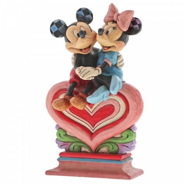 Disney Mickey and  Minnie A figurine of both characters sitting on a red, pink and cream heart hugging each  otherother