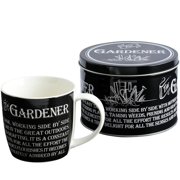 Picture shows a black tin with humorous garden messages, tin contains a cup for the Gardener.  The tin can be used for nice biscuit or three.