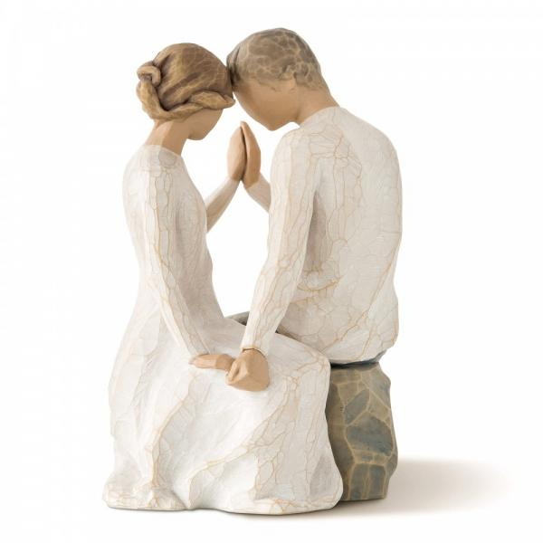 Willow Tree Around You is a figurine of a man and woman sitting together on a rock with both hands touching each other and both heads touching