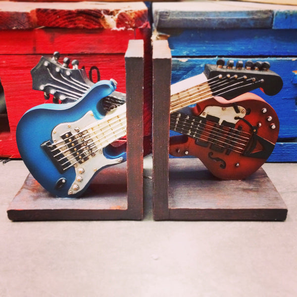 Guitar bookends is two sided each with a half guitar one red and one blue for music lover