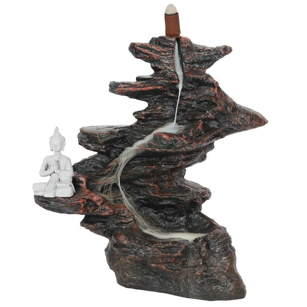 Buddha on rocks meditating Place a cone on top of the mountain ans see the smoke  slowly make its way down the mountain