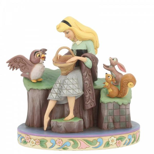 Disney Sleeping Beauty figurine is sitting on a rock wth her furry friends Owl Rabbit and red squirrel holding a scarf and basket