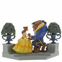 Disney Beauty and the beast happy here is both sitting on a bench holding hands with 2 flower pots on both sides