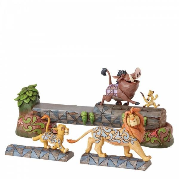 Carefree Comrades shows  Timon and Pumbaa walking on a log with tails up.  Also included is an interchangeable  baby Simba and adolescent Simba