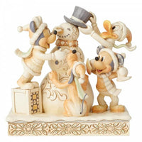Disney figurines with baby Mickey, Minnie, Pluto and Donald duck building a snowman