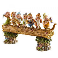 This Classic piece features the homeward bound scene from Snow White were the seven dwarfs  crossing a log with Doc holding a lantern