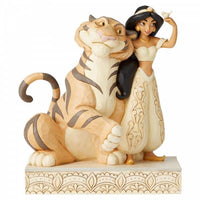 Disney Jasmine and Rahah the lion standing on a rock with jasmine holding a little bird