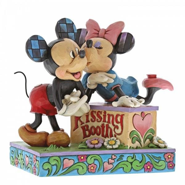 This piece features Minnie Mouse leaning on a box inscribed with the words kissing booth, kissing Mickey Mouse.
