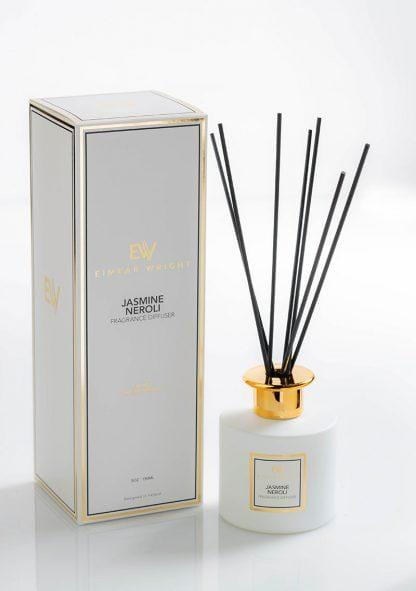 This picture shows a glass diffuser with a gold collar and designed in Ireland, with its packaging, French fragrance oils scented Jasmine Neroli from Eimear Wright. Lovely fragrance best seller.