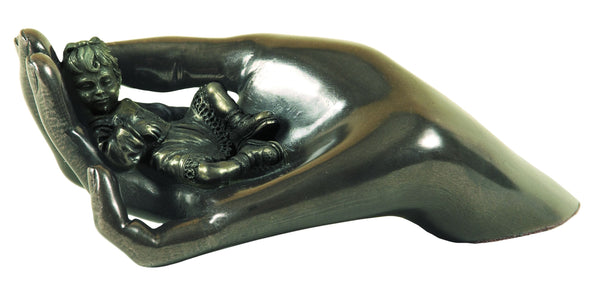 This Genesis piece shows a small girl sleeping in the gentle embrace of a woman's hand
