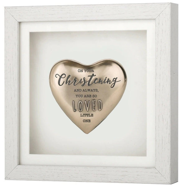 "This Genesis item shows a heart shaped piece with the inscription ""On your Christening and always, you are so loved little one"".  It is contained in a white wooden frame."