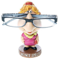 Mum's spec holder has a figurine with a pink dress and yellow scarf. You can place your glasses on her nose for safekeeping