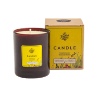 This picture shows a handmade candle from Ireland, with its packaging, a box with a yellow label  CANDLE scented lemongrass & cedarwood.  Lovely fragrance burns evenly.