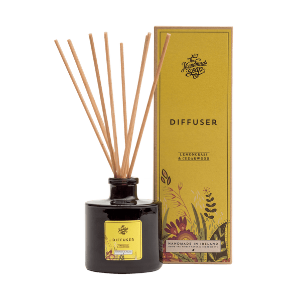 This picture shows a glass diffuser with aroma sticks from Ireland, with its packaging, a box with a yellow label  scented lemongrass & cedarwood. Lovely fragrancer the most wonderful fragrance Best seller