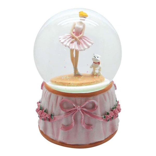 Snow Globe with a ballerina and dog with pink bows around the base. Turns to a melody