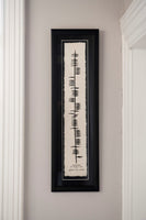 "Contained in a black wooden frame is a piece of parchment with ancient Irish writing Ogham declaring ""bless this house"" in English and in  Irish.  This is a particularly large piece over 60cm long.   Designed and made in Ireland."