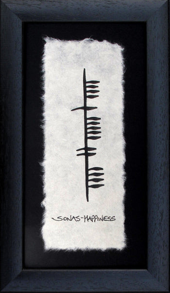 Conained in a black wooden frame is a piece of parchment with ancient irish writing Ogham declaring Happiness (sonas)) Designed and handmade in Ireland