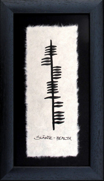 "Contained in a black wooden frame is a piece of parchment with ancient Irish writing Ogham declaring  an old Irish toast ""Slainte"" (health).  Designed and made in Ireland."